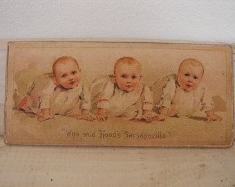 vintage advertising label on wooden tag, Hood's Sarsaparilla, Victorian babies, infants, toddlers