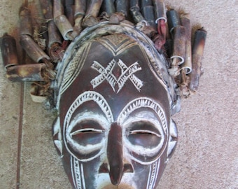 Vintage African tribal carved wooden mask with hair ( pieces of reed and pieces of cloths)