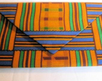 Handmade cotton African Kent cloth envelope clutch.