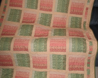 Peach and green rail fence quilt