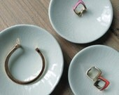 Set of three tiny porcelain dishes
