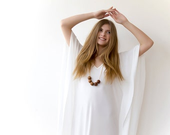 White tunic with dolman sleeves