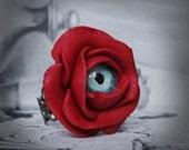 Bague oeil fleur rouge