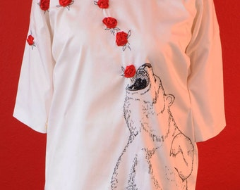White dress with hand-embroidered bear and roses