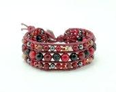 Cute elephant charm red coral wrap bracelet.
