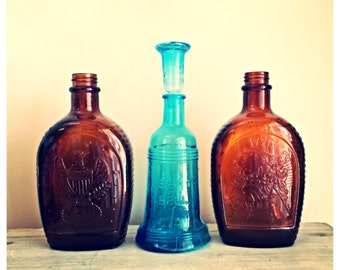 Vintage blue liberty bell bottle / Amber log cabin syrup bottles / glass bottles / nautical / supply bottle set / blue bitters bottle