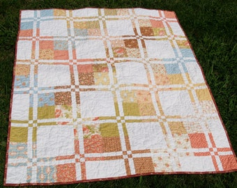 Soft Floral/White Disappearing 4 Patch Quilt