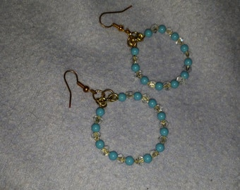 Hand crafted hoop earrings. These are made with turquoise beads and Swarovski crystals.