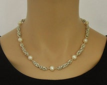 Silver chain maille necklace with white freshwater pearls