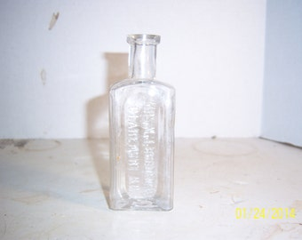 1890's Mrs MJ Bradford Claremont NH 4 7/8 inch Clear food bottle
