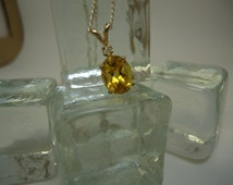 Oval and Round Cut Citrine and Sapphire Necklace in Sterling Silver