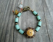 Bohemian Bracelet with Teal Buri Beads and Ceramic Bead Focal.  Gift for Her.