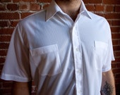 Sheer, damn-near mesh 80s short sleeved button down white shirt by Kool Knit. Size 16/M.