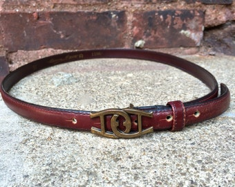 vintage Etienne Aigner belt  // oxblood leather // brass buckle // 1970s