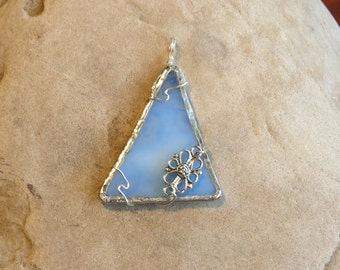 blue and white stained glass pendant with charm