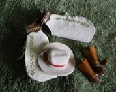 Cowboy clothing, ready to go to work, hat, chaps and boots   PM 75