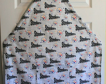 NFL Pittsburgh Steelers Apron. Adjustable ties to fit any size. Pocket in front.