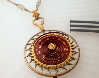 Steampunkology Neo-Victorian Steampunk Necklace, Optical Monocle Lens, Antique Clock Gears, Red Enamel Porcelain Pocket Watch Dial and Parts
