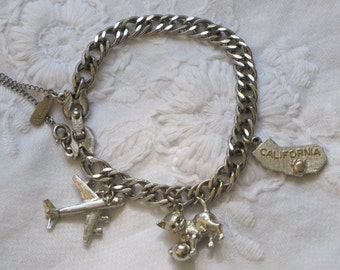 Silver Tone MONET Charm Bracelet with Three Charms