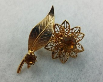 Small Gold Tone Flower Brooch with Citrine Rhinestones