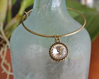 Adjustable antique gold bangle bracelet with a crystal Swarovski chrystal charm
