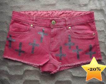 Cross print studded shorts