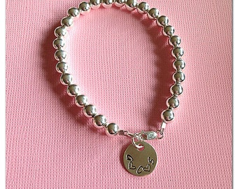 Sterling silver beaded bracelet with sterling silver charm and clasp.