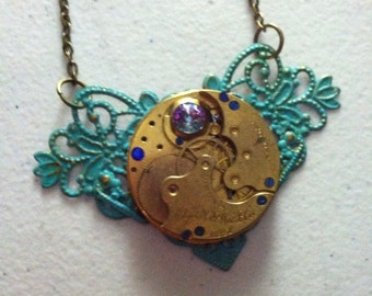 SALE - Patina painted Steampunk vintage heart necklace- brass Elgin movement and Swarovski crystal jewel and blue sapphire