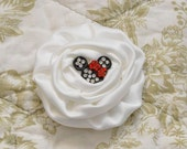"""White flower with """"Minnie Mouse"""" rhinestone center."""