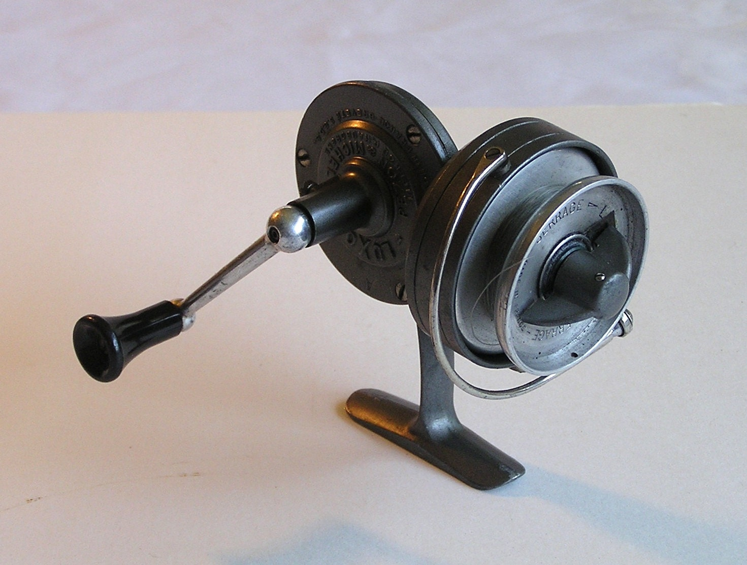 Vintage luxor mer pezon et michel fishing reel by for Antique fishing reels