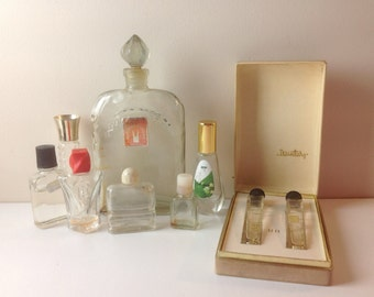 Vintage soviet perfume bottles. Some have small amounts of perfume remaining.