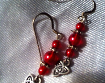 Red and sterling silver pierced earrings with sterling silver plated triad charms.