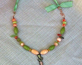 Lucite Beaded Necklace with Jade Scott Pendant and Ribbon