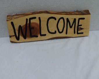 Natural Edged Cedar Welcome Sign will make your guest feel welcome