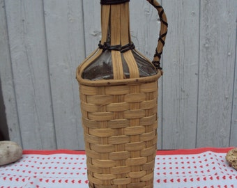 Rare glass bottle covered with Wicker, dating from the 1930s.
