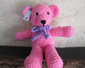 Lovely soft traditional teddy bear, in pink