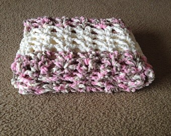 A pretty pink extra thick and soft crib size crocheted baby girl blanket