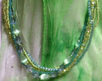 Hand beaded necklace, shades of blue and green.