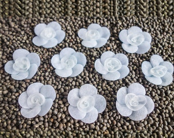 Small soft blue Pinwheel Flowers with Coiled Ribbon Centers