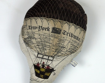 Brown hot air balloon handmade shaped cushion with a stripy  fabric on the back