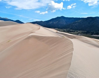 Great Sand Dunes mountains clouds blue sky