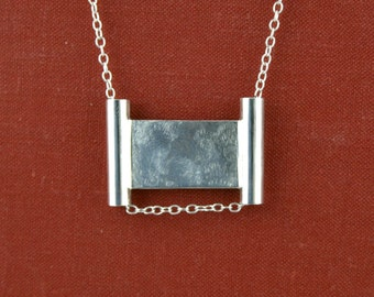 Brushed panel and tube pendant necklace in sterling silver