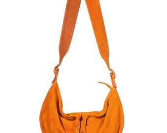 Suede crossbody bag in orange-yellow color