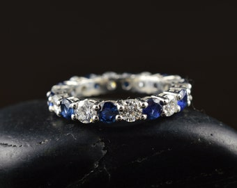 Stella - Blue Sapphire and Diamond Eternity Band in White Gold, Round Brilliant Cut, Shared Prong with Open Baskets, Free Shipping