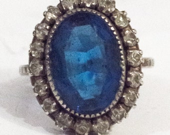 Blue cocktail silver ring surrounded by marcasite stones.