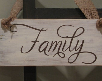 """Hand panted wooden """"Family"""" sign with burlap hanger on pallet wood."""