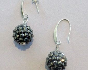 Gorgeous dangle earrings with black disco ball