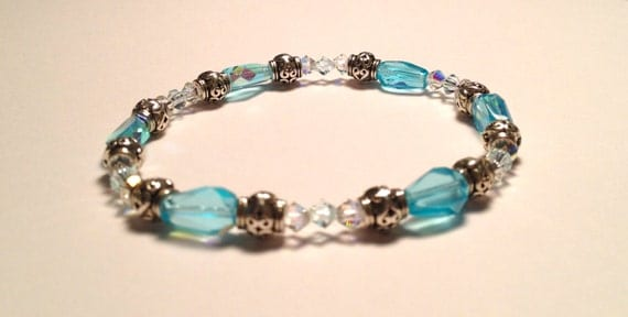 Bracelet with clear light turquoise shimmering glass beads, silver plated spacer and Swarovski clear crystals