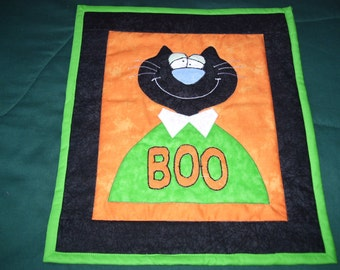 Halloween cat that has a message for everyone. He is machine quilted and appliqued and ready to hang!