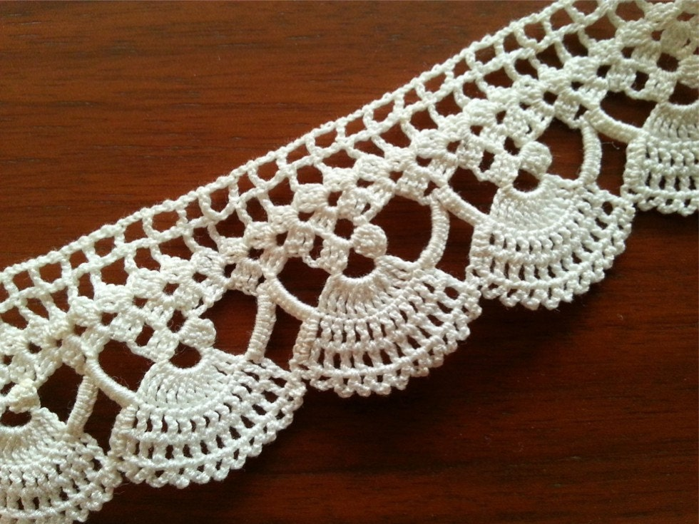 Sweet and delicate, this crochet trim is perfect for embellishing garments, pillows and home décor or craft projects.